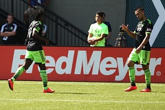Photo Credit: TRIBUNE PHOTO: JAIME VALDEZ - Clint Dempsey (right) of the Seattle Sounders gets congratulations from teammate Obafemi Martins after scoring the second goal in their team's 4-2 victory Sunday on the road against the Portland Timbers.
