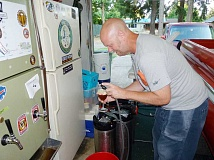 Photo Credit: COURTESY PHOTO: JASON BARKER - Jason Barker brews beer made from purified sewage effluent mixed with Tualatin River water in his cramped Hillsboro garage, near a refrigerator bearing the bumpersticker I Brew, Therefore I Am.