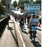 Photo Credit: DAVID F. ASHTON - As the sun comes up, Providence Bridge Pedal riders gear down for the Sellwood Bridge crossing over the Willamette River.