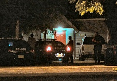 Photo Credit: DAVID F. ASHTON - Police investigate the report of a gunshot, fired on or near S.E. Harney Street.