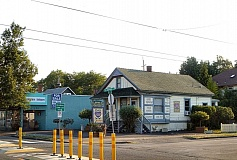 Photo Credit: EILEEN G. FITZSIMONS - These two buildings, at the northeast corner of 13th and Spokane Streets in Sellwood, appear headed for demolition. The one on the left, built in 1926, was recently Farmhouse Antiques; the one on the right, dating to 1908, was originally a residence before rezoning to commercial use sometime after the 1950s. The Love Art! Gallery closed in early August after five years in the house.