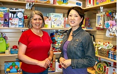 Photo Credit: RITA A. LEONARD - Carolyn Miye, owner of Sellwoods Oodles 4 Kids, at right, stands with sales clerk Cynthia, whom she describes as her store angel.