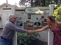 Photo Credit: SUBMITTED PHOTO - Former McLean House and Park President Mike Watters joins hands with designer Leah Desatoff to celebrate the new interpretive sign Aug. 23.
