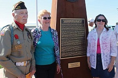 Photo Credit: HOLLY M. GILL - World War II veteran Robert McHaney and sisters Mary Gleason, left, and Julie Naegele, the daughters of Leland W. Schawo, who was stationed at the Madras Airport during World War II, helped dedicate the Veterans War Memorial Plaza at the airport on Saturday. The sisters flew in from Nebraska and Kansas, respectively, for the event.