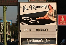 Photo Credit: HILLSBORO TRIBUNE PHOTO: DOUG BURKHARDT - The Runway opened Monday at 1735 S.E. Tualatin Valley Highway, where the controversial Gems gentlemens club was located. Gems, which opened in October 2013, closed in June after the death of Gems owner Frank Hurliman. The Runways business license states it is a full-service restaurant and bar, yet the sign out front indicates The Runway is a gentlemens club as well. Michael Bean of Hurlies Inc. is listed as the owner of the business.