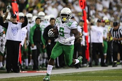 Photo Credit: TRIBUNE PHOTO: JAIME VALDEZ - Byron Marshall runs for an Oregon Ducks touchdown against South Dakota.