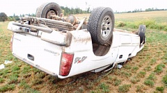 Photo Credit: CLACKAMAS COUNTY SHERIFF'S OFFICE - Six teens were hurt when this pickup flipped near Molalla on saturday, Aug. 30. The driver, Karnily Bodunov, 18, was airlifted for a head injury and faces DUII charges.