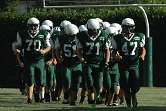 Photo Credit: ESTACADA NEWS: PARKER LEE - The Estacada football team takes to the field last season.