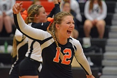 Photo Credit: JOHN WILLIAM HOWARD - Junior setter  Ashley MacInnis lets out a yell after winning a point in the second game of the Tribe's straight set victory over Gladstone in Tuesday's season opener.