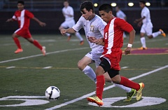 Photo Credit: THE OUTLOOK: DAVID BALL - Centennials Jorge Perez chases down a ball in the midfield alongside Milwaukies Vance Quarton during Thursdays 3-2 loss to the Mustangs.