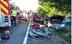 Photo Credit: CONTRIBUTED PHOTO - Estacada Fire personnel extracted two injured people from a Toyota after a car accident on Springwater Road on Thursday, Sept. 4.