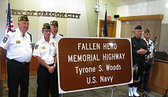 Photo Credit: PHOTO BY: RAYMOND RENDLEMAN - Oregon City veterans gather in City Hall to protect the newly unveiled roadside memorial sign for Tyrone Woods before it was installed Friday on Highway 213.