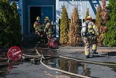 Photo Credit: TVF&R - Tualatin Valley Fire & Rescue firefighters rescue pets from burning apartments on Farmington Road after safely rescuing tenants trapped inside building.