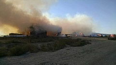 Photo Credit: PHOTO COURTESY OF CCFR - The hay piles were still burning as of Monday morning.