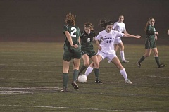 Photo Credit: SPOKESMAN FILE PHOTO - Ali Bourque attempts to kick the ball out of an opponent's posession.