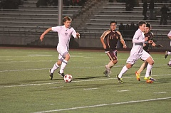Photo Credit: SPOKESMAN FILE PHOTO - Jason Johnson scoots the soccer ball up the field against Milwaukie last year.