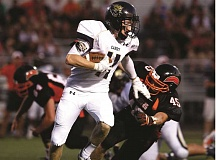 Photo Credit: MICHAEL SULLIVAN/THE NEWS-REVIEW - Josh Payne had an 87-yard touchdown against Roseburg.