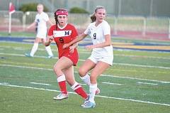 Photo Credit: COREY BUCHANAN - Makenzie Lee and the Canby girls soccer team lost to McMinnville Thursday night.