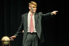 Photo Credit: SETH GORDON - Pointed questions - Junior Travis Cox plays the lead role of amateur investigator George Manning in Newberg High School's presentation of 'Fatal Combination,' an improvisational and rather silly murder mystery, at 7 p.m. Friday and Saturday.
