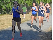 Photo Credit: TIMES PHOTO: MATT SINGLEDECKER - Valley Catholic sophomore Julia Clark and Ermina Clark pushed each other at the Tualatin Invite and helped the Valiants show well in their first race of the season.