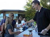 Photo Credit: TIDINGS PHOTO: KATE HOOTS - Willamette Principal David Pryor serves up smiles to Jacki Craven, fourth grade, and her mother Aimee at the schools welcome-back event Sept. 4.