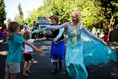 Photo Credit: TIMES PHOTO: ADAM WICKHAM - Representatives from Once Upon a Time Princess Parties embrace the crowd at the 57th annual Beaverton Celebration Day Parade on Saturday.