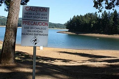 Photo Credit: HILLSBORO TRIBUNE PHOTO: DOUG BURKHARDT - New warning signs are now up at the Sain Creek Picnic Area at Hagg Lake, site of the tragic drowning deaths of four Hillsboro family members Aug. 25.  The five permanent signs were put up this afternoon.