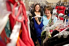 Photo Credit: TIMES PHOTO: JAIME VALDEZ - Michelle Woodworth, left, and Pam Engel have formed a nonprofit called Diva Days, which offers free dresses to girls for homecoming and prom. The next dress giveaway is this Saturday at Tigard High School.