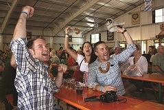 Photo Credit: FILE PHOTO - Party-goers enjoy music in one of the festival's venues.