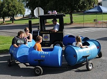 Photo Credit: BILL VOLLMER - The Crooked River Ranch Lions Club's mini train transports children during last year's event. The train will return for the parade at 10 a.m. Saturday, Sept. 13.
