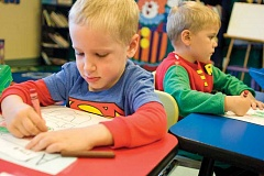 Photo Credit: KEVIN SPERL - 'Superman' Albert McDaniel, left, and 'Robin Hood' Brendan Joyce, students in Kim Spurgeon's pre-school class, take part in Super Hero Day at the Crook County Christian School.