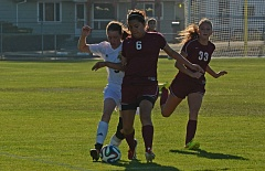 Photo Credit: JOHN WILLIAM HOWARD - St. Helens freshman Sidney Allen (9) battles Giselle Manzo of The Dalles for possession late in the first half of the Lions' 6-1 win over the Riverhawks on Sept. 11.