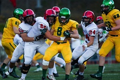 Photo Credit: DAVID BLAIR - West Linn's Dylan Tuor tries to shake off a bevy of Oregon City tacklers during last week's season opener at home. The Lions knocked off rival Oregon City 28-21.