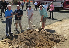 Photo Credit: OUTLOOK PHOTO: BEVERLY CORBELL - Retired firefighters, from left, Mike McCormick, Rich von Allmen, retired District 10 Fire Chief Don Handewith and Mike Glenn toss the first shovels of dirt for construction of the new Fire Station 76.