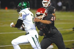 Photo Credit: THE OUTLOOK: DAVID BALL - David Douglas Vilay Phommanvahn tackles West Linns Qawi Ntasa on a kickoff return Friday night.