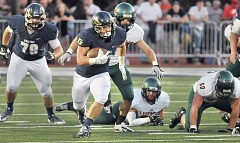 Photo Credit: SETH GORDON - Busting loose - Sophomore John Shaffer breaks free for a 68-yard run during George Fox's 47-33 home loss to La Verne Saturday at Stoffer Family Stadium. Shaffer finished with 153 yards and one touchdown on 27 carries.