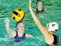 Photo Credit: SETH GORDON - Ball movement - Katrina Reichenbach flicks a pass during Newberg's 13-1 home win over Southridge Sept. 11 at Chehalem Aquatic Center. The Tigers went 3-3 in six games last week.