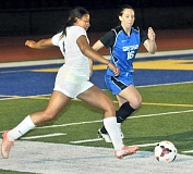 Photo Credit: SETH GORDON - Incoming - Junior forward Tiana Gilyard launches a cross during Newberg's 2-2 draw versus Gresham Sept. 11 at Loran Douglas Field. Gilyard set up Lindsay Louis for the Tigers' first score of the contest.