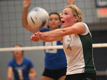 Photo Credit: THE OUTLOOK: DAVID BALL - Reynolds Lauren Tennyson bumps a ball into the front row during the second set of Tuesdays win at Gresham.