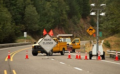 Photo Credit: ESTACADA NEWS PHOTO: TROY WAYRYNEN - Highway 244 is closed in the affected area of the 36 Pit Fire. Officials have wartned that the road will likely remain closed even after firefighters leave due to unstable conditions created by the fire on the slopes above the roadway.