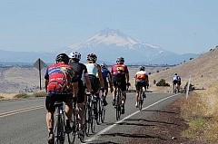 Photo Credit: BILL VOLLMER - Riders with Cycle Oregon rode from Tygh Valley to Madras on Wednesday, Sept. 10, by way of Kah-Nee-Ta. At right, riders  crest the hill at Wolfe Point, on their way toward the town of Warm Springs, with Mount Jefferson in the background. The cyclists spent parts of three days and two nights in Madras, pitching their tents at Juniper Hills Park and enjoying local restaurants and businesses on Thursday.