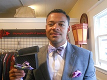 Photo Credit: TRIBUNE PHOTO: SCOTT KEITH - Jahmal Landers, one of the founding members of Bowyer and Fletcher, says, If you dress well, and take time out of your day to put on a tie, youre going to be in a much better mood.