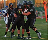 Photo Credit: DAN BROOD - TIGER PRIDE -- Tigard senior running back Landon Floyd (23) celebrates with his Tiger teammates after scoring a touchdown in the season-opening win over Grant.