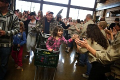 Photo Credit: TIMES PHOTO: JONATHAN HOUSE - Amarah Bennett gets high-fives from Cabela's employees during opening day for the new Tualatin store.
