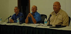Photo Credit: ESTACADA NEWS PHOTO: ISABEL GAUTSCHI - Clackamas County Commissioners Paul Savas, Jim Bernard and Chair John Ludlow listen a citizen's question during a town hall meeting in Estacada on Sept. 10.