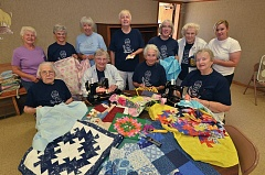 Photo Credit: COURTESY: PROVIDENCE HEALTH AND SERVICES - The Rockwood Quilters, including Providence account resolution specialist Andrea Hobgood, standing third from right, gather to sew quilts for Providence Portlands new NICU.