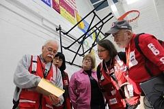 Photo Credit: NEWS-TIMES PHOTO: JOHN SCHRAG - Red Cross volunteers get their marching orders as they prepare to welcome displaced residents from the Scoggins Creek Fire. No evacuees stayed overnight Friday as the blaze continued to spread.