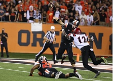 Photo Credit: COURTESY OF BRUCE MCCLAIN - Oregon State quarterback Sean Mannion beats the rush to get off a pass Saturday night at home against San Diego State.