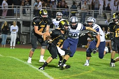 Photo Credit: JOHN BREWINGTON - St. Helens junior Bryce Bumgardner looks to dance around oncoming Wilsonville linebacker Garrett Chenoweth during the Lions' 42-28 loss on Sept. 19.