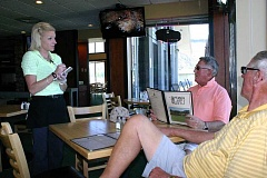 Photo Credit: JASON CHANEY - Angel Quinn takes a lunch order from Howard Zangari (center) and Jim Richards.
